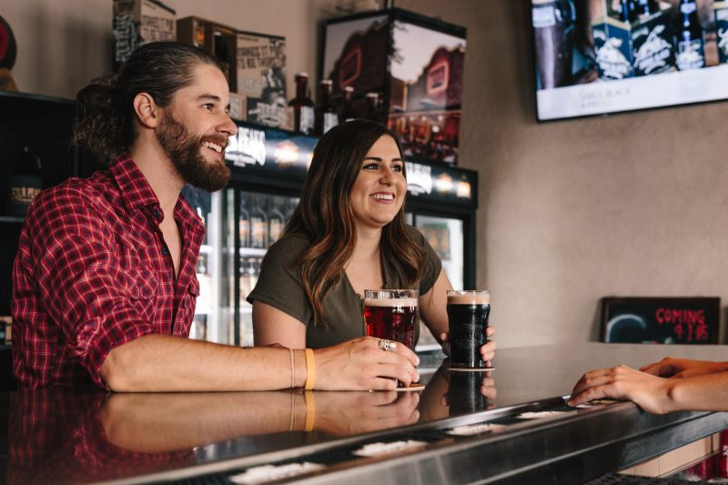 a man and women having a drink together in a bar, meeting in real life